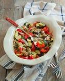 Baked vegetables in baking dish. Vegetarian food. Selective focu stock photo