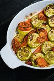 Baked vegetables in baking dish, zucchini, bell pepper and zucchini. stock photos