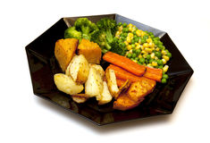 Baked vegetables on a black plate Royalty Free Stock Photo