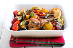 Baked vegetables and chicken drumstick Stock Images