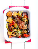 Baked vegetables and chicken drumstick Royalty Free Stock Photos
