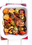 Baked vegetables and chicken drumstick Royalty Free Stock Images