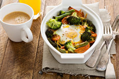 Baked vegetables with an egg on top Stock Images