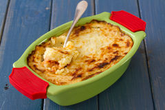 Baked vegetables with fish in green dish Stock Images