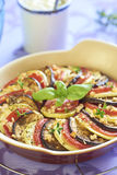 Baked vegetables with garlic and herbs Stock Photo