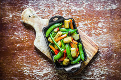 Baked vegetables on rustic background Stock Photo