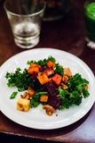 Baked vegetables, walnuts and kale salad stock images