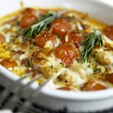 Baked white asparagus. With cherry tomatoes on rosemary Stock Photo