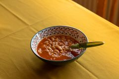 Baked white beans aka kuru fasulye, traditional turkish food. Served on table royalty free stock images