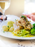 Baked white fish fillet with broccoli Royalty Free Stock Photo