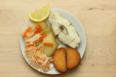Baked white fish with lemon Stock Images