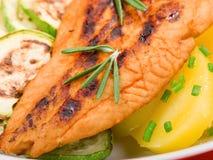 Baked whitefish with orange juice Royalty Free Stock Images