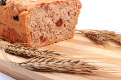 Baked wholemeal bread and ears of wheat Stock Photo