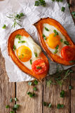 Baked Yam Filling With Egg And Tomato Close-up On The Table. Vertical Top View Stock Image