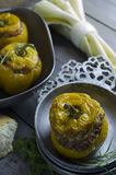 Baked yellow peppers. Stuffed with meat and rice in rustic metal bowl Stock Images