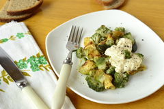 Baked zucchini and broccoli with sour cream sauce Stock Photo