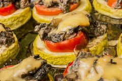 Fried zucchini with mushrooms tomato and cheese Stock Photo