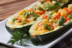 Baked zucchini stuffed with vegetables closeup Stock Images