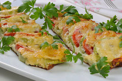 Baked zucchini with tomatoes and cheese Stock Photo