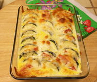 Baked zucchini. Zucchini baked with tomatoes and cheese sauce in a glass dish Royalty Free Stock Photography