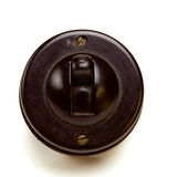 Bakelite Switch. Old Vintage bakelite light switch isolated against white background from low perspective Royalty Free Stock Photo