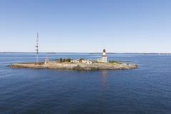 Baken en communicatie toren op een eiland Stock Foto