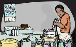 Baker. Black male baker puts icing on a cake Stock Image
