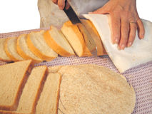 Baker. At the bakery cutting bread Stock Images
