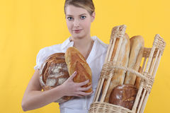 Baker. Proud baker holding basket of bread Royalty Free Stock Photos