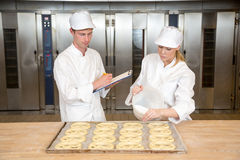 Baker apprentice and instructor in bakery Royalty Free Stock Images