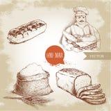 Baker avec le panier de boulanger du pain frais, pain coupé en tranches de pain, Français doux durcissent l'eclair et le sac avec Photographie stock