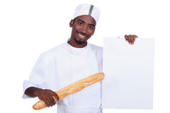 Baker with a baguette Stock Photos