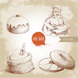 Baker with baker basket of fresh bread, sesame bagel with cream cheese, iced sweet bun with cherry and sack with whole flour with Royalty Free Stock Images