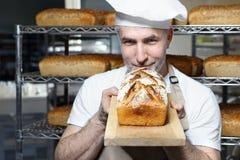 Baker in the bakery. Baking bread. royalty free stock photo