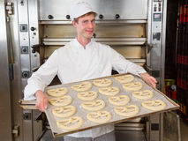 Baker with baking plate full of pretzels Royalty Free Stock Photos