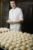 Baker With Balls Of Bread Dough Ready To Bake Royalty Free Stock Image