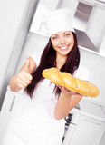 Baker with bread Royalty Free Stock Photo