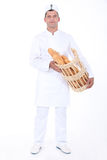 Baker with bread basket. Baker stood with bread basket Stock Photography