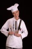 Baker with cake spatulas 1. Uniformed female Bakery Chef holdingcake spatulas Royalty Free Stock Image
