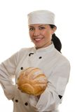 Baker or Chef. A smiling chef holding a loaf of bread Stock Photo