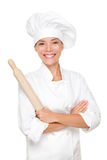 Baker / Chef woman. Smiling happy holding baking rolling pin wearing uniform isolated on white background. Beautiful young mixed race Asian Caucasian female stock images