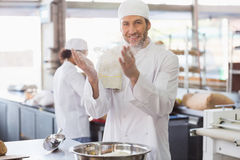 Baker clapping flour from his hands Royalty Free Stock Photography