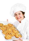 Baker with Cookies. Baker holding up a tray of fresh hot chocolate chip cookies.  Isolated on white Royalty Free Stock Photos