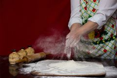 Baker cooking bread. Woman slaps flour over cutting board Royalty Free Stock Images