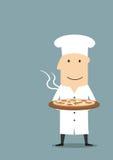 Baker dans le chapeau blanc avec la pizza de pepperoni chaude Photos stock