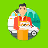 Baker delivering cakes. A baker holding a box of cakes. A baker delivering cakes. A baker with cupcakes standing on the background of delivery truck. Vector Royalty Free Stock Images
