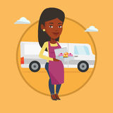 Baker delivering cakes vector illustration. Delivery woman holding a box of cakes. Baker delivering cakes. Woman with cupcakes standing on the background of Stock Images