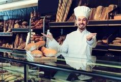 Baker is demonstrating assortment. Of bakery Stock Image