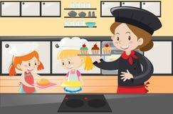 Baker et enfants dans la cuisine Photo libre de droits