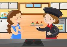 Baker et femme dans la cuisine Photographie stock libre de droits